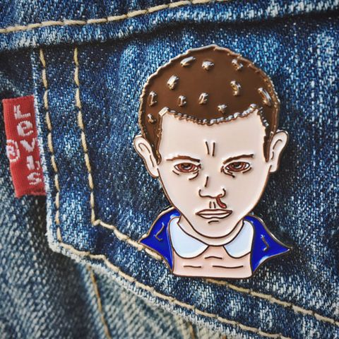 Cheek, Denim, Textile, Electric blue, Pocket, Button, Stitch, Painting, Thread,