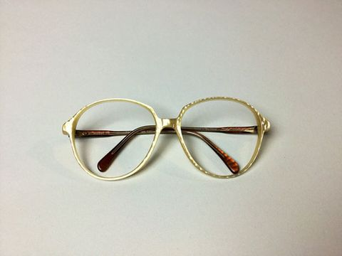 Eyewear, Vision care, Amber, Metal, Eye glass accessory, Tan, Circle, Silver, Transparent material, Still life photography,