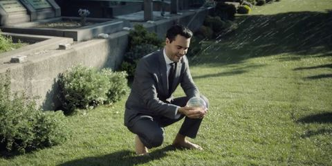 Grass, Sitting, Suit, Formal wear, People in nature, Blazer, Suit trousers, Knee, Grass family, Barefoot,