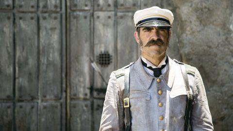 Dress shirt, Cap, Collar, Sleeve, Military person, Soldier, Facial hair, Uniform, Beard, Peaked cap,