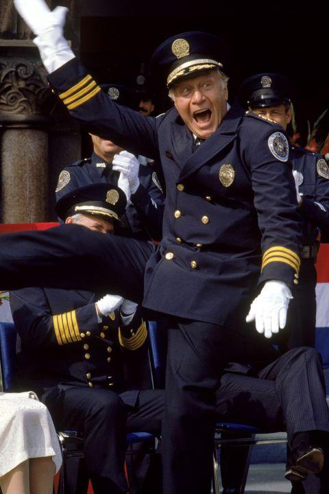 Shoe, Uniform, Hat, Cap, Military person, Gesture, Military officer, Glove, Law enforcement, Peaked cap,