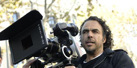 Camera, Television crew, Video camera, Hand, Cameras & optics, Camera operator, Videographer, Filmmaking, Jacket, Beard,