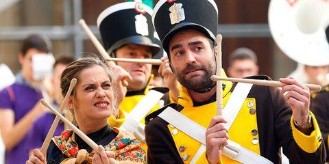 Hand, Cap, Musician, Wind instrument, Musical instrument, Facial hair, Band plays, Celebrating, Musical ensemble, Beard,