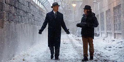 Sleeve, Standing, Photograph, Winter, Hat, Headgear, Blazer, Street fashion, Snow, Gesture,
