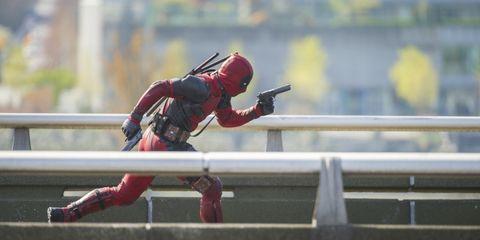 Carmine, Fictional character, Helmet, Toy, Sports gear, Boot, Supervillain, Hero, Action figure, Superhero,