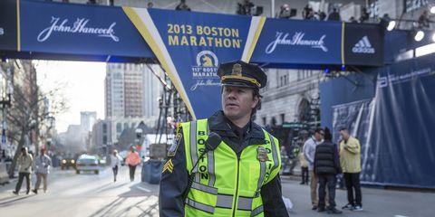 Police, Official, Police officer, Security, Pedestrian, Metropolitan area, Street, Uniform, Law enforcement, Road,