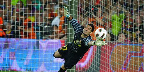 Ball, Football, Soccer ball, Sports equipment, Grass, Team sport, Soccer player, Sport venue, Ball game, Shoe,