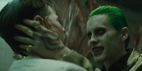 Green, Jaw, Interaction, Organ, Fictional character, Acting, Gesture, Scene, Fiction, Joker,