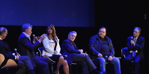 Footwear, Shoe, Chair, Stage, Electric blue, Conversation, heater, Convention, Television program, Collaboration,