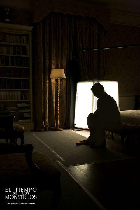 Lighting, Room, Interior design, Shelf, Darkness, Shelving, Curtain, Bookcase, Window treatment, Lamp,