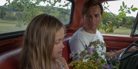 Nose, Summer, Vehicle door, Shrub, Car seat, Bouquet, Brown hair, Automotive window part, Garden, Annual plant,