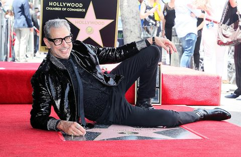 Carpet, Red carpet, Flooring, Event, Performance, Eyewear, Premiere, Sitting, Fictional character, Glasses,