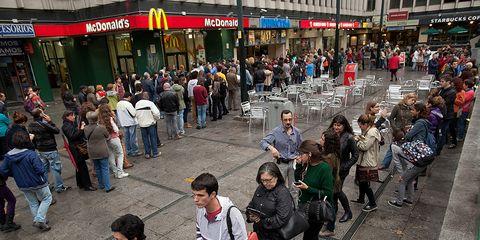 Footwear, Crowd, Infrastructure, Public space, Road, City, Jeans, Street, Urban area, Pedestrian,