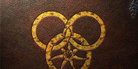 Brown, Yellow, Amber, Pattern, Symbol, Circle, Symmetry, Visual arts, Peace,