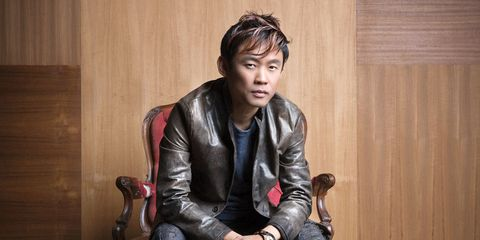Jacket, Hand, Outerwear, Sitting, Leather, Leather jacket, Black hair, Bag, Wood stain, Top,