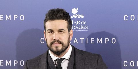 Suit, Chin, Facial hair, White-collar worker, Beard, Event, Tuxedo, Formal wear, Premiere, Television presenter,
