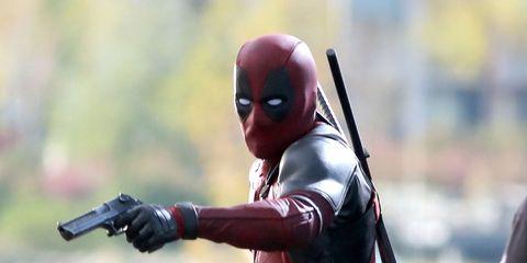 Red, Toy, Fictional character, Carmine, Action figure, Figurine, Costume, Hero, Superhero, Revolver,