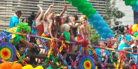 People, Event, Green, Party supply, Parade, Colorfulness, Balloon, Party, Public event, Carnival,