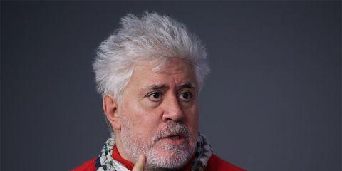 Hand, Facial hair, Beard, Sweater, Moustache, Single-lens reflex camera, Wrinkle, Action figure, Camera, Revolver,