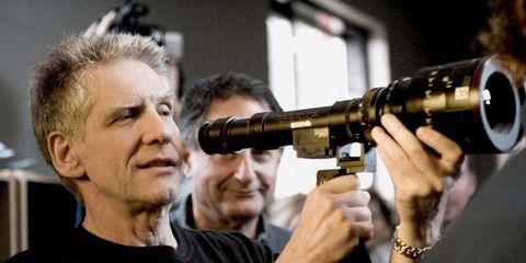 Camera, Cameras & optics, Lens, Optical instrument, Camera lens, Sweater, Gesture, Photographer, Digital camera,