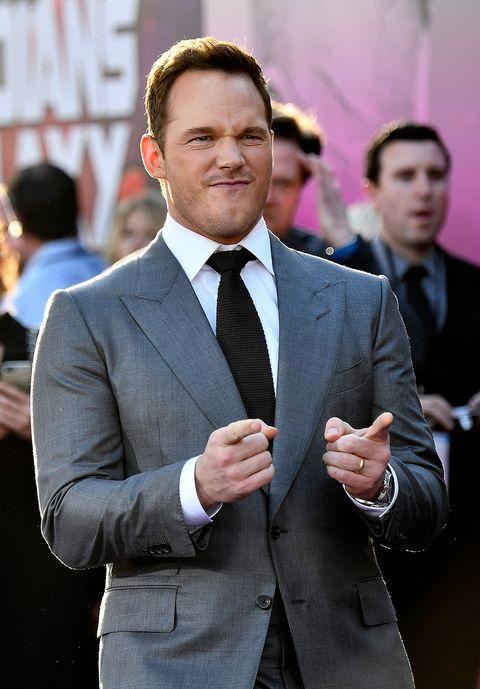 Suit, Formal wear, White-collar worker, Tuxedo, Event, Businessperson, Tie, Blazer, Gesture, Premiere,