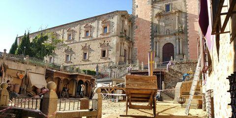 Arch, Medieval architecture, History, Arcade, Ancient history, Village, Flag, Hacienda, Historic site, Courtyard,