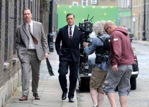 Clothing, Trousers, Coat, Shirt, Outerwear, Standing, Camera, Video camera, Suit trousers, Television crew,