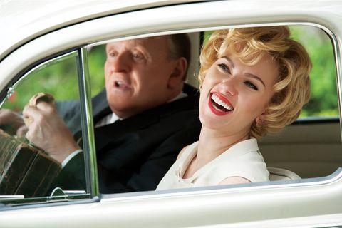 Motor vehicle, Nose, Mouth, Automotive exterior, Vehicle door, Mammal, Photograph, Glass, Car seat, Automotive mirror,