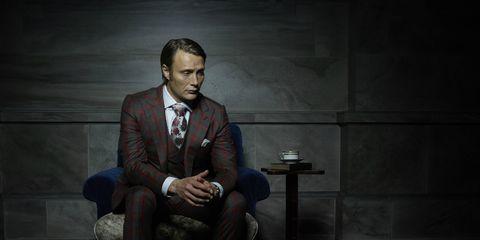 Dress shirt, Collar, Sitting, Formal wear, Suit trousers, Blazer, Darkness, Thinking, Tuxedo,