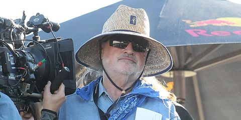 Eyewear, Hat, Camera, Video camera, Facial hair, Sunglasses, Jacket, Cameras & optics, Costume accessory, Sun hat,