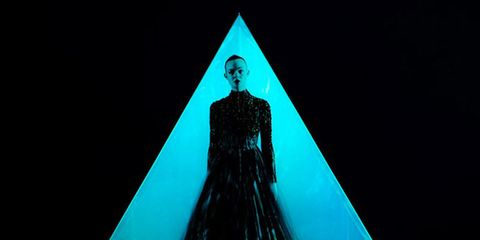 Costume design, Electric blue, Aqua, Gown, Triangle, Fashion design, Haute couture, Fictional character, Mantle, Cloak,
