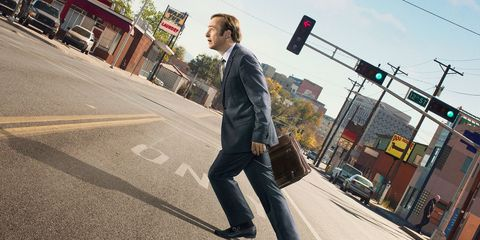Trousers, Road, Infrastructure, Coat, Collar, Outerwear, Urban area, Standing, Road surface, Asphalt,