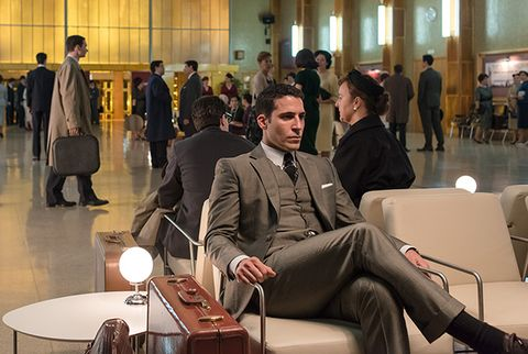 Trousers, Suit, Furniture, Coat, Blazer, Suit trousers, Hall, Coffee table, Conversation, Tie,