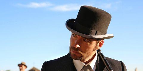 Coat, Hat, Dress shirt, Collar, Suit, Facial hair, Outerwear, Formal wear, Style, Headgear,
