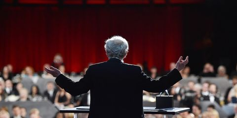 Bandleader, Conductor, Crowd, Audience, Orator, Event, Public speaking, Performance, Orchestra, Musician,