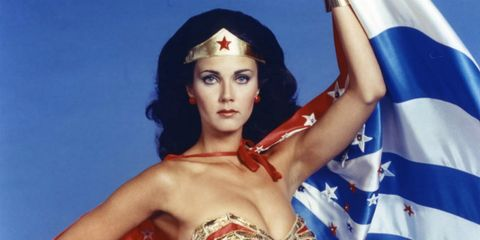 Hairstyle, Strapless dress, Flag, Wonder Woman, Dress, Headgear, Costume, Fashion, Youth, Costume accessory,