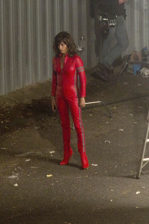 Latex, Carmine, Latex clothing, Fictional character, Costume, Leather, Curtain, Boot, Costume design, High heels,