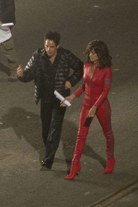 Leg, Human body, Standing, Costume, Gesture, High heels, Acting, Fictional character, One-piece garment, Dance,