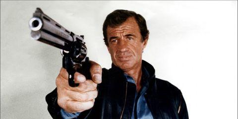 Jacket, Collar, Firearm, Standing, Shooting, Revolver, Air gun, Gun barrel, Trigger, Shotgun,