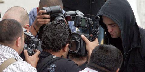 Camera, Cameras & optics, Mammal, Video camera, Lens, Camera accessory, Digital camera, Camera operator, Film camera, Videographer,