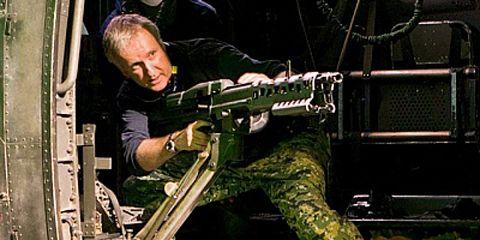 Soldier, Machine gun, Musical instrument accessory, Military person, Shooting, Employment, Shotgun, Military camouflage, Air gun, Military,
