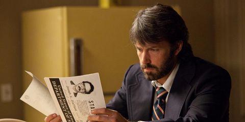 Watch, Facial hair, Suit, Dress shirt, Tie, Sitting, Publication, Beard, Blazer, White-collar worker,