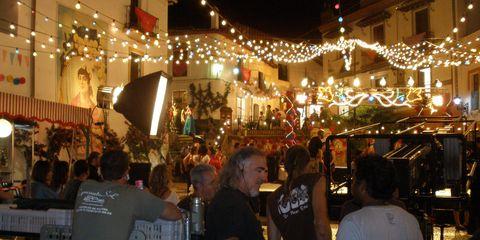 Lighting, Customer, Electricity, Market, Marketplace, Light fixture, Trade, Bazaar, Festival, Electrical supply,