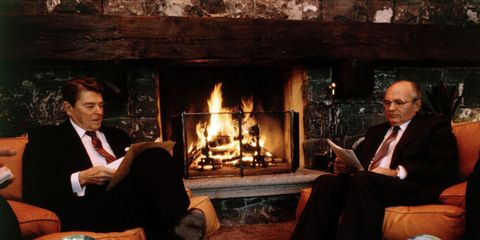 Hearth, Sitting, Heat, Fireplace, Living room, Flame, Fire, Conversation, Gas, Coffee table,