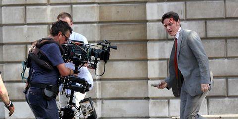 Footwear, Leg, Video camera, Camera, Outerwear, Coat, Television crew, Camera operator, Videographer, Film camera,