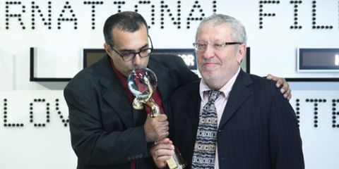 Eyewear, Glasses, Vision care, Coat, Suit, Trophy, Blazer, Award ceremony, Award, Tie,