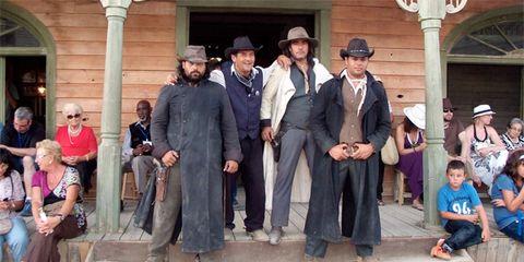 Clothing, Leg, People, Trousers, Human body, Coat, Hat, Formal wear, Headgear, Temple,