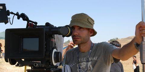 Hat, Cameras & optics, Camera accessory, Cap, Video camera, Filmmaking, Camera, Camera operator, Machine, Videographer,