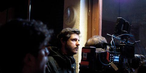 Jacket, Video camera, Film camera, Camera, Filmmaking, Beard, Videographer, Cinematographer, Cameras & optics, Camera operator,