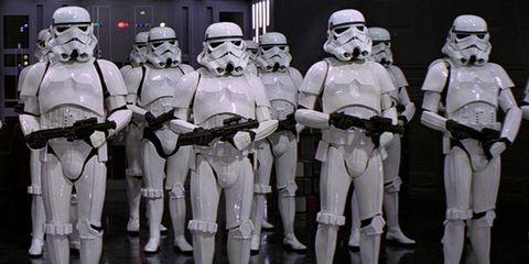 Standing, Helmet, Personal protective equipment, Fictional character, Machine, Robot, Armour, Troop, Mecha, Action figure,